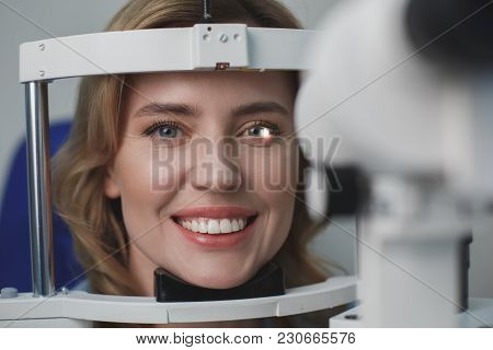 Portrait Of Close Up Beaming Woman Checking Eyes In Ophthalmological Center. Eye Care Concept