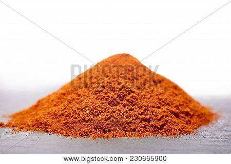 Red Ground Paprika On Dark Grey Background, Shallow Depth Of Field, Top View, Close-up, Macro, Backl