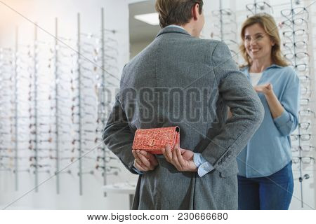 Male Secreting Spectacle Case For Smiling Woman. They Speaking With Each Other. Eyesight And Gift Co