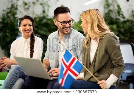 Group Of People Discussing Plans In Informal Atmosphere