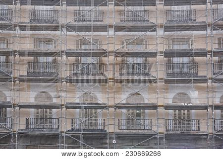 Scaffolds On An Antique Building. Restoration Works. Architecture, Construction Background