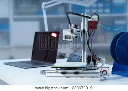 3D printer and computer on the table