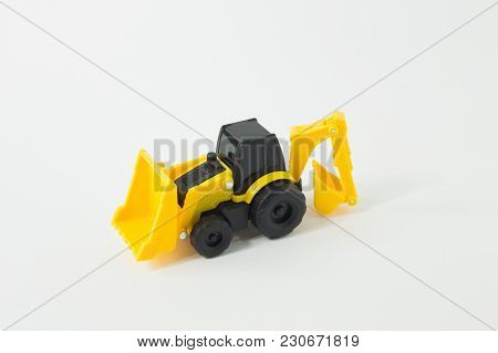 The Yellow Tractor Loader Toy On White Background Isolation Image.