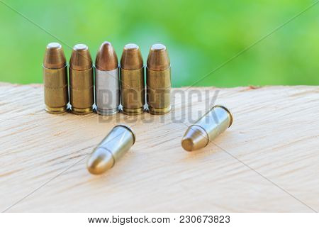 Cartridge On The Wooden Floor And Green Wall Background.