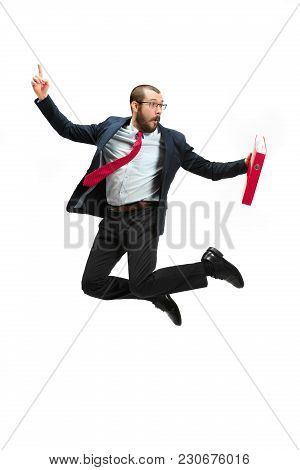 Funny Cheerful Businessman Jumping In Air Over White Studio Background. Jump Of Happy Bearded Young