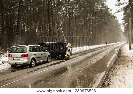 Car Accident On The Slippery Road In Early March