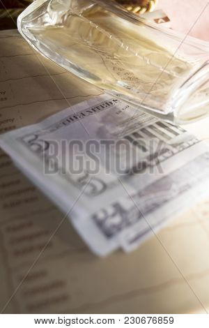 Perfume Bottle Near Some Banknotes On A Page Of An Address Book