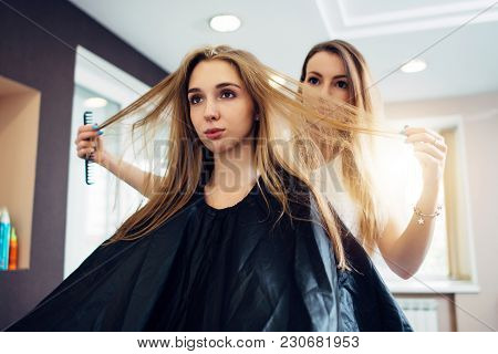 Hairdresser And Customer Discussing, Deciding, Choosing How To Cut The Hair In Hairdressing Salon.
