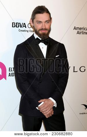 LOS ANGELES - MAR 4:  Tom Payne at the 2018 Elton John AIDS Foundation Oscar Viewing Party at the West Hollywood Park on March 4, 2018 in West Hollywood, CA