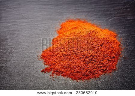 Red Ground Paprika Isolated On Dark Grey Background, Shallow Depth Of Field, Top View, Close-up, Mac