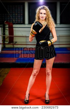 Glamour Fashion Model Woman With Boxing Gloves In Sports Gym.