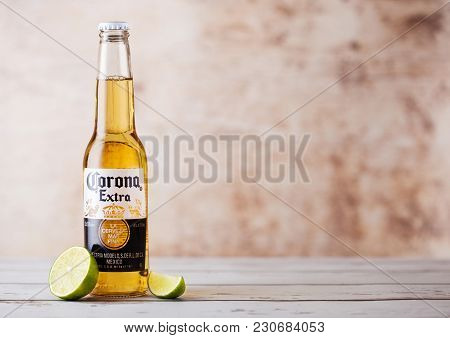London, Uk - March 10, 2018 : Bottles Of Corona Extra Beer With Lime Slice On Wooden Background.coro