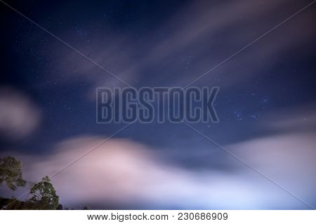 Star Cluster In The Night Sky With Cloudy And Windy Weather, Traveling In Thailand