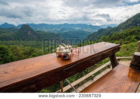 Set Of Flavoring Was Used For Cook On Wooden Table With Mountain View In Countryside Restaurant