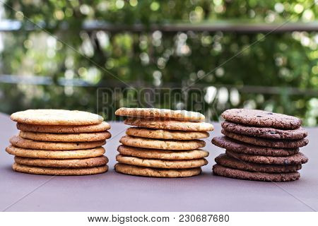 Different Types Of Cookies. Stacks Of Chocolate Cookies, Cookies With Chocolate Drops, Cookies With