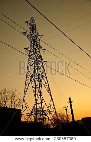 Electricity pylons and lines at sunset . Enargy distribution.