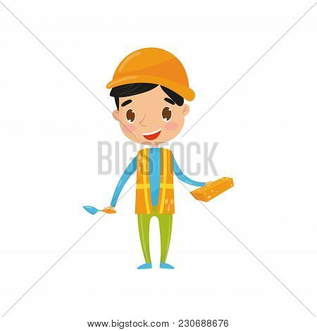 Teen Boy In Orange Waistcoat With Reflective Strips And Protective Helmet, Holding Brick And Trowel.