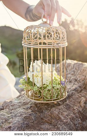 Cage For Birds With Flowers. Decor. Birdcage With Flowers Wedding Decoration