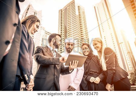 Arabic And Western Business People Speaking About Investments