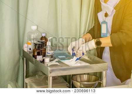 The Nurse With Lots Of Medicine Is Preparing Or Cleaning The Stitch Of Her Woman Patient After Surge