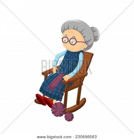 Old Gray-haired Grandmother, Sits In A Cozy Chair Rocking, Embroidering And Knitting With Threads. P