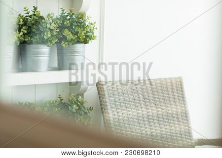 Cozy Artificial Rattan Chair In Little Garden Take A Photo From Inside Room Through Window.