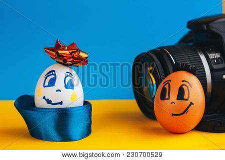 Two Cute, Elegant Eggs With Faces, Posing In Front Of The Camera. Easter A Time To Dress Up Your Tab
