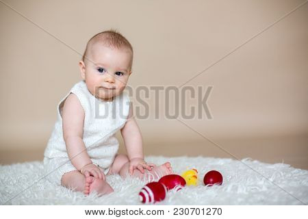 Close Portrait Of Cute Little Baby Boy, Isolated On Beige Background, Baby Making Different Facial E
