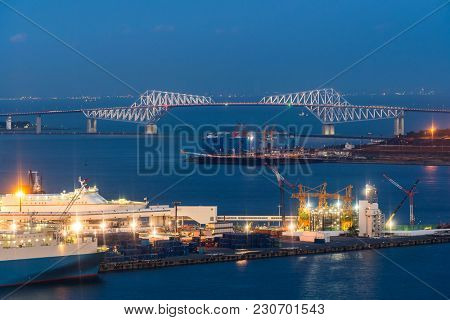 Tokyo Industrial port in Tokyo bay with Tokyo Gate bridge in background, Japan.