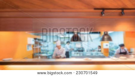 Commercial Kitchen Blurred Background with chef cooking