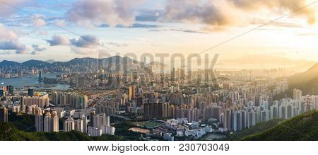 Hong Kong Skyline Kowloon from Fei Ngo Shan hill or Kowloon Viewing Point sunset panorama