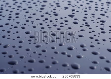 Abstract Of Water Rain Drop On Car Glass, Drops Over Black Shinny Background. Texture
