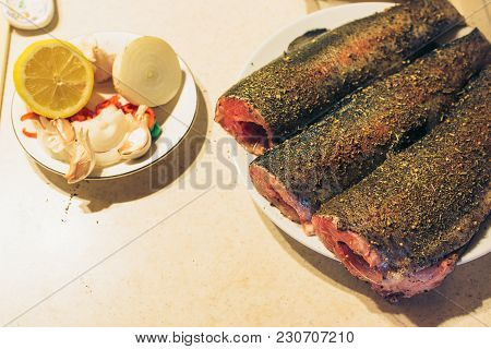 Fresh Trout With Spices And Seasoning On Cutting Board.