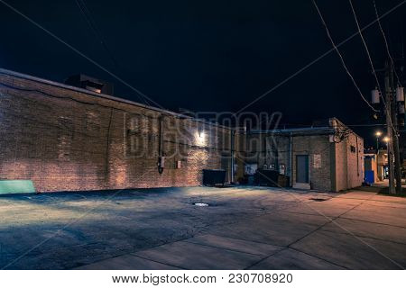 Urban warehouse building and loading dock at night