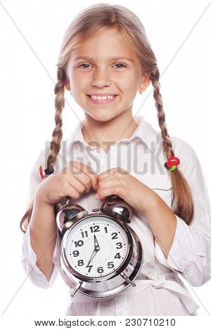 Cute little girl with alarm clock isolated on white background