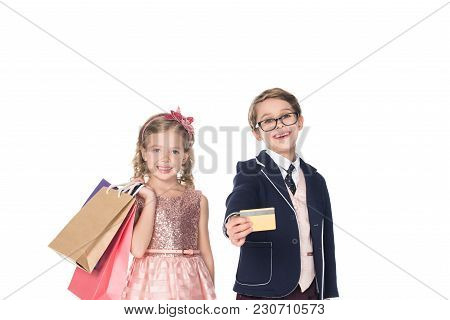 Beautiful Stylish Children With Shopping Bags And Credit Card Smiling At Camera Isolated On  White