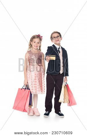 Adorable Stylish Kids With Shopping Bags And Credit Card Smiling At Camera Isolated On White