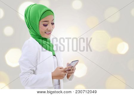 Happy Asian Muslim Woman Holding A Phone