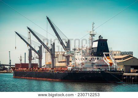Bulk Carrier Cargo Ship Unloading In The Port