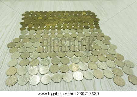 Close Money, New Coins, Clean Background. Bi-metal Coin Was Introduced In March. These Coins Are Dat