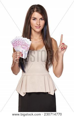 Woman With Euro Money Paper Currency In Hand Pointing Finger Up, Over White Background