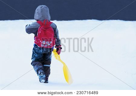 The Boy Goes. Winter Games Are Over (children, Happiness, Game)