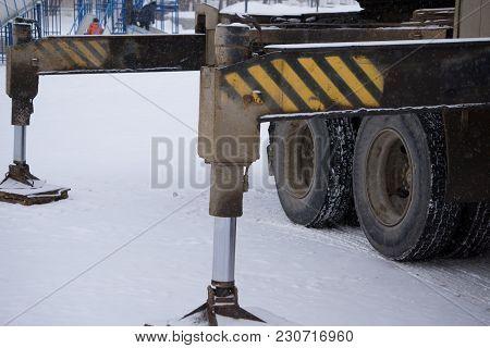 Hydraulics Crane Support. Hydraulics Crane Support Is On Gravel. Focus On The Hydraulics Crane Suppo
