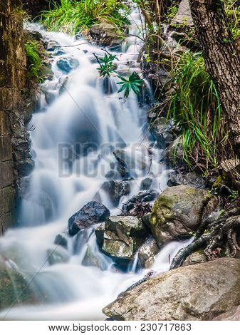 Fast Flowing Water Of A Mountain River With Motion Blur