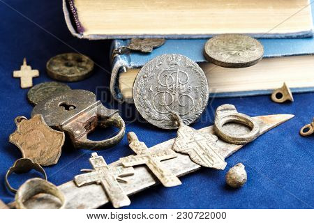 On A Blue Cloth Background, Ancient 19th-century Coins, A Rusty Knife