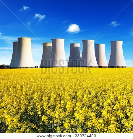 Panoramic View Of Nuclear Power Plant Jaslovske Bohunice With Golden Flowering Field Of Rapeseed - S