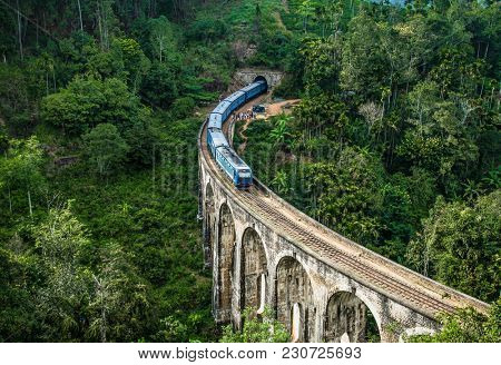 ELLA SRI LANKA - DEC 330,2016: Train on the Nine Arches Demodara Bridge or the Bridge in the sky on Dec 30, 2016, Sri Lanka. Nine Arches Bridge is located in Demodara near Ella city Sri Lanka.