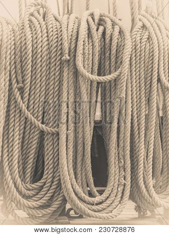 Old Fashioned Harbor Marina Sail Boat Ropes. Yachting Details And Objects Concept.