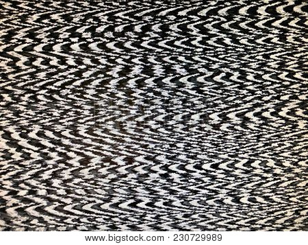 Fuzzy static interference screen display tv monitor black and white zig zag abstract background