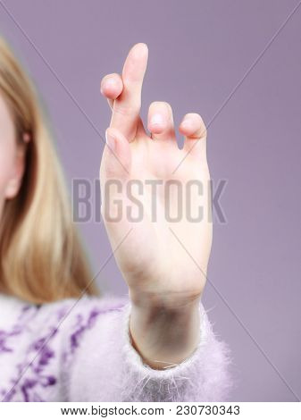 Gestures And Signs Concept. Woman Hand Making Promise Gesture With Fingers Crossed.